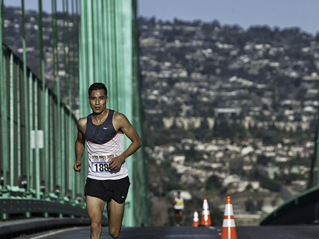 Conquer the Bridge Run winner overall Francisco Garcia